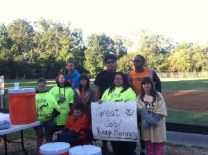 Students cheering on runners at the much-needed water station. PHOTO: Patty Cripe