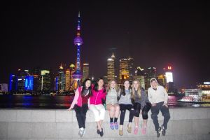 Paul VI students Molly Cox, Eleanor Lane, Abby Mix. Kathleen McLean, Dave Capen at night in Shanghai. Courtesy of Liangyan Wang.