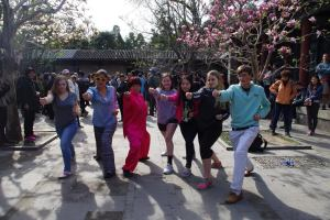 Eleanor Lane, Molly Cox, Abby Mix, Kathleen McLean, Dave Capen take a Taiji lesson. Photo courtesy of Liangyan Wang.