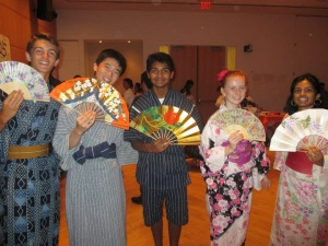 Our roommates brought with them a yukata (summer kimono) for the girls and a jimbe for the boys for us to wear during the festival. This is me with the other members of the American government presentation group. (Caitlin Kwalwasser, Panther Press)