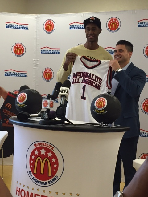 VJ King is presented with a McDonald's All-American Game jersey by McDonald's representative Carlos Mateos, Jr. at a press conference honoring King's selection to the McDonald's All-American basketball team. (Adam Sylvain/ Panther Press)