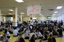 Students designated as Third World received red armbands and rice and water for lunch. PHOTO: Eileen Curren